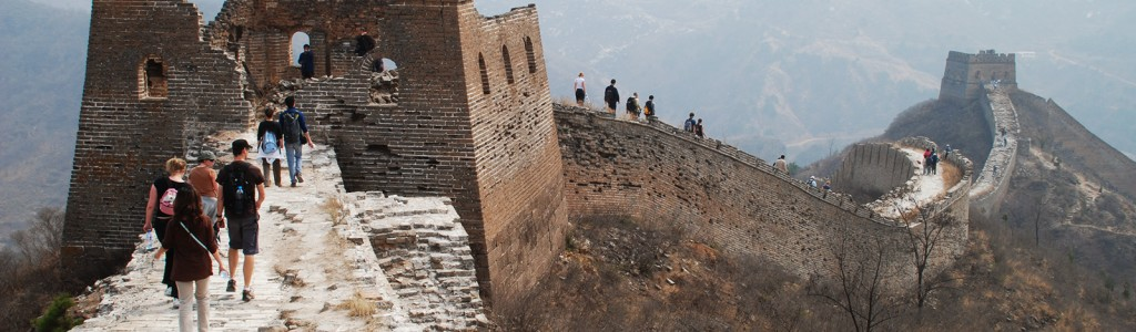 A group of people walking along the Great Wall of China