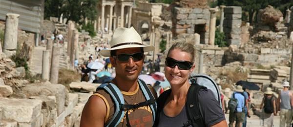 couple posing in front of ruins