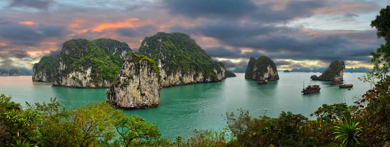 Sunset and cloudy skies over Halong Bay in Vietnam