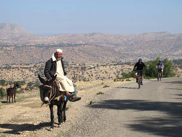 Cyclists and old man on donkey, Anti Atlas